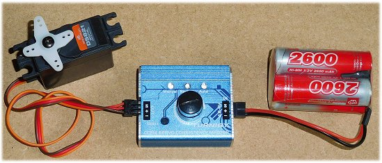 RC servo tester connects between battery pack and servo