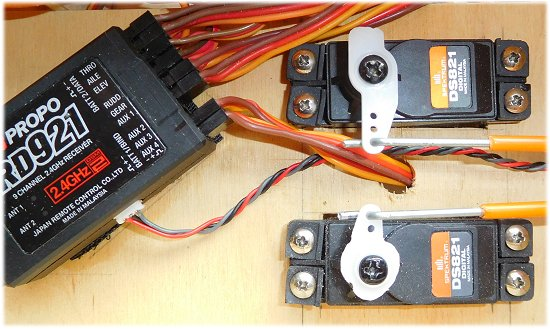 Two standard rc servos screwed to a ply tray